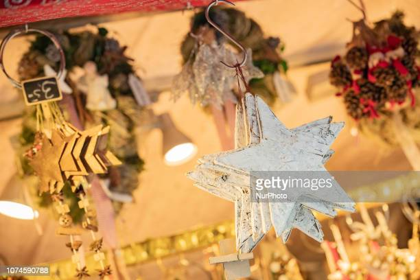 Some christmas stars hanging The most important christmas market of Munich at Marienplatz was full of visitors because of the warm weather