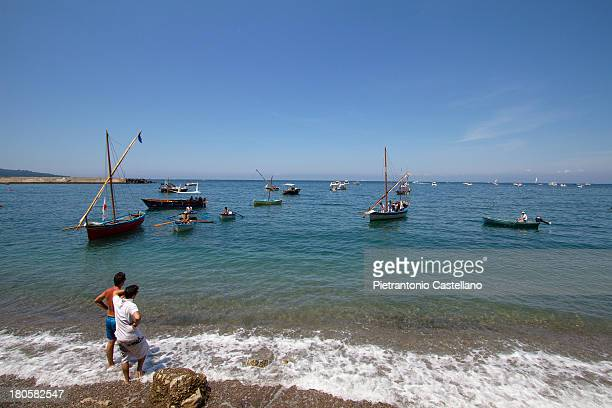 CONTENT] Some classic gozzi ancient fishing boats restored or rebuilt by traditional carpenters at anchor off the Marina di Alimuri beach near...