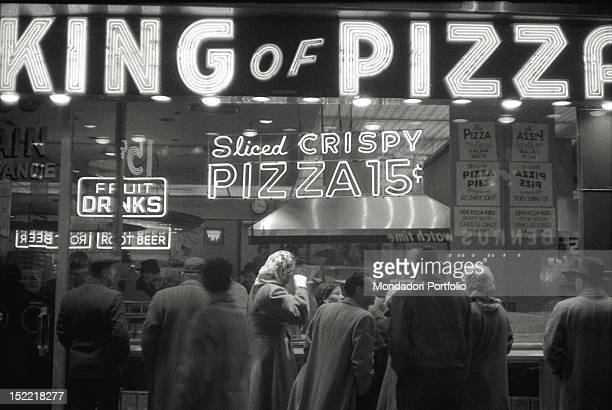 Some clients are waiting for their turn in the crowded pizzeria 'King of Pizza' in New York New York