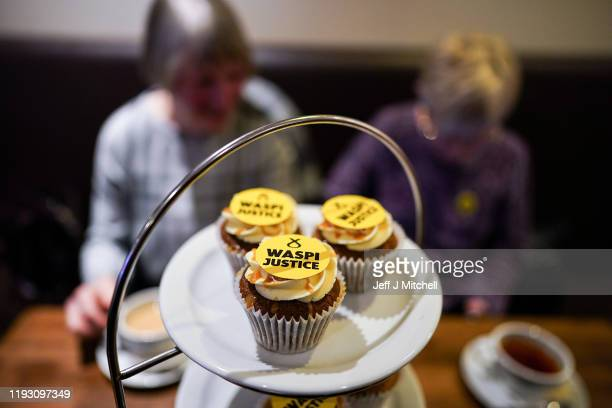 Some cupcakes with the words 'WASPI Women' are displayed as Nicola Sturgeon and SNP general election candidate Mhairi Black campaign at Bianco E Nero...