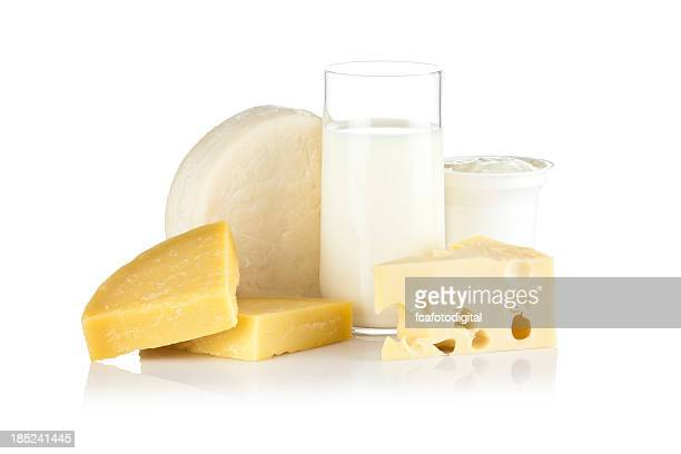 some dairy products shot on reflective white background - dairy stock photos and pictures