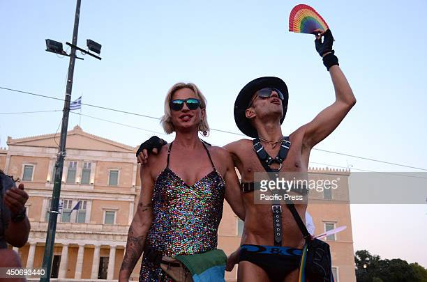 Some dancers pose in front of the Greek parliament buildings during the 2014 Gay Pride Parade of Athens Hundreds of people on Saturday joined...