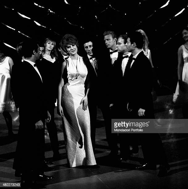 Some dancers surrounding Italianborn Swiss singer and TV presenter Mina while rehearsing a part of the TV variety show Studio Uno at Teatro delle...
