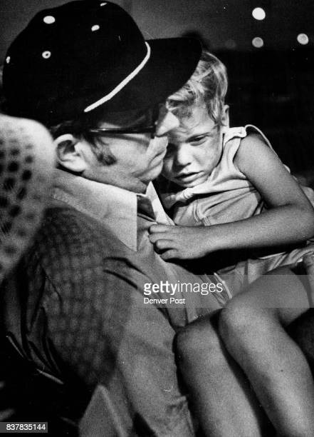 Some Days a Guy Just Can't Make a Dime Fouryearold Dan Curran isn't in the best of spirits as he's carried by his father Jim after being hit by a...