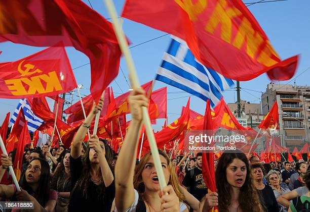 Some demonstrators waving the Communist Party of Greece flags during a demonstration against the government measures for the Greek economic crisis...