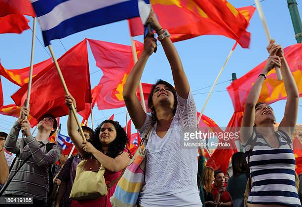 Some demonstrators waving the Communist Party of Greece flags during a demonstration against the government measures for the Greek economic cirsis...