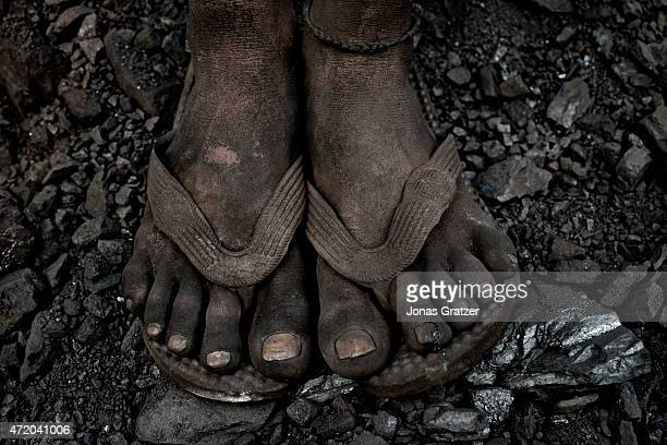 Some dirty feet at the coal mine in Jharia Jharia in India's eastern Jharkand state is literally in flames This is due to the open cast coal mining...