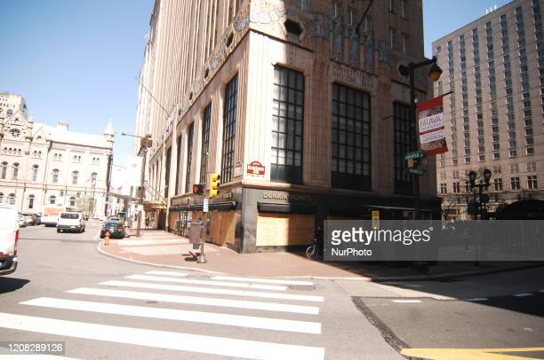 Some downtown businesses have boarded up to protect their merchandise in Philadelphia PA on March 26 2020