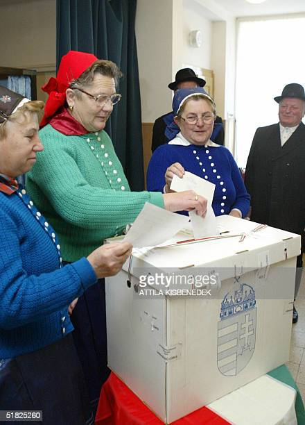 Some elderly local women in traditional Hungarian dresses, prepare their votes at the polling station of the cultural center in Veresegyhaz, some 30...
