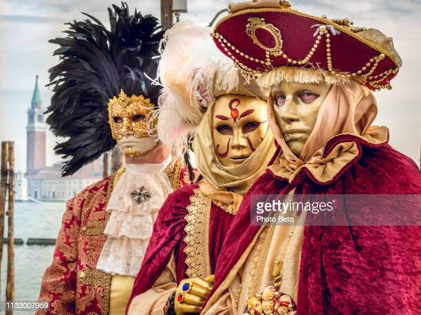 some elegant masks near the st mark square during the venice carnival - venice carnival stock pictures, royalty-free photos & images