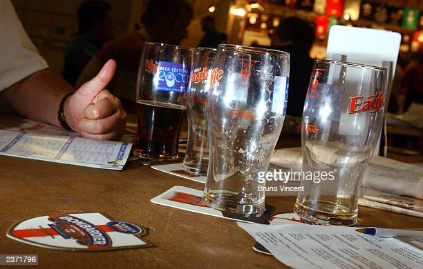 Some empty glasses are left on a table at the Great British Beer Festival at the Olympia Exhibition Center August 5 2003 in London England