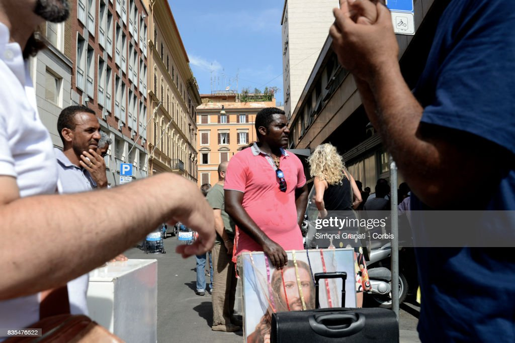 Some evicted refugees take away sacred images of Christ on August 19, 2017 in Rome, Italy. Police evict approx 500 Eritrean and Somali refugees form an occupied building in Piazza Indipendenza.