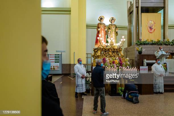 Some faithful pray in front of the Statue of the Santi Medici present in the Basilica Santuario of the Santi Medici in Bitonto on October 18 2020 For...