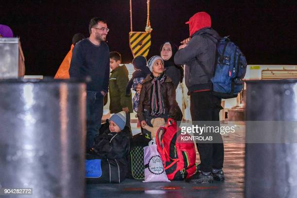 Some family of migrants during the landing by ship Diciotti of the Italian Coast Guard occurred in the port of Crotone in Calabria southern Italy The...