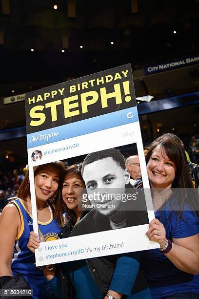 Some fans hold up a happy birthday sign for Stephen Curry of the Golden State Warriors on March 14 2016 at Oracle Arena in Oakland California NOTE TO...