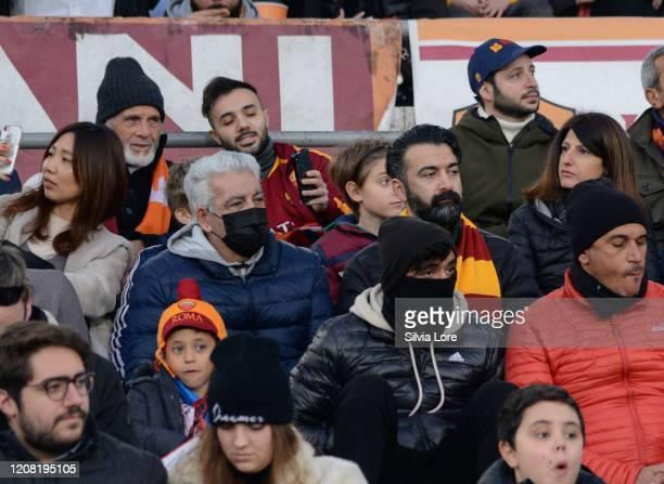 Some fans wear masks at the stadium to protect themselves from coronavirus COVID-19 during the Serie A match between AS Roma and US Lecce at Stadio...