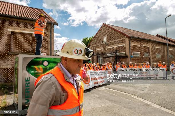 Some fifty mining employees take part in an action called by the CFDT union on June 16 2017 outside the premises of the ANGDM agency for the rights...