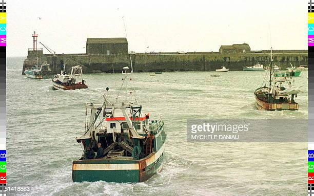 Some French fishing boats leave the Normand port of Granville 02 December to claim the right to fish in the contested zone of the Sark Box and...
