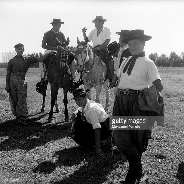 Some gauchos kids pose looking at the camera they are the typical South American cattlemen the equivalent of North American cowboys found in the...