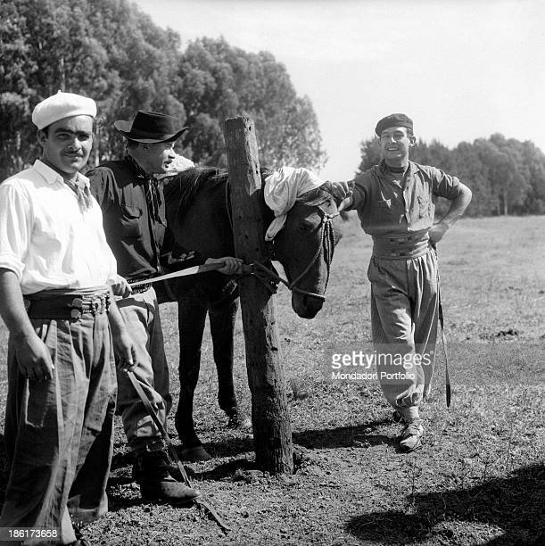 Some gauchos pose standing in a moment of relax they are the typical South American cattlemen the equivalent of North American cowboys found in the...
