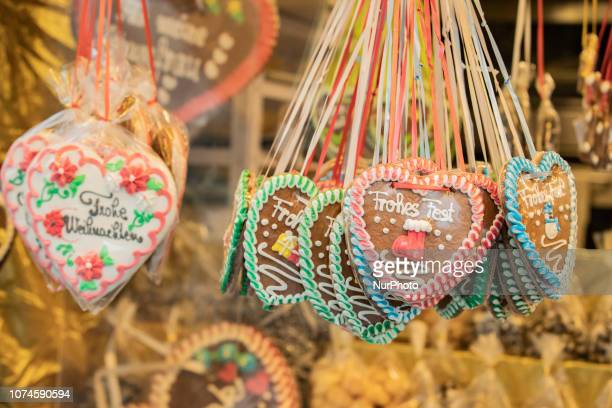 Some Ginger Bread Hearts wishing merry christmas The most important christmas market of Munich at Marienplatz was full of visitors because of the...