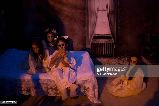 Some girls dressed up as zombies take part in the Halloween celebrations in Churriana near Malaga on October 31 2017 / AFP PHOTO / JORGE GUERRERO