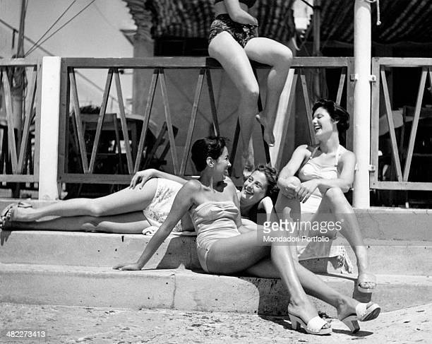 Some girls in swimsuit laughing on a staircase Livorno 1950s