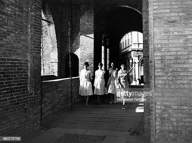 Some girls walking along the drawbridge of the Este Castle Ferrara August 1959