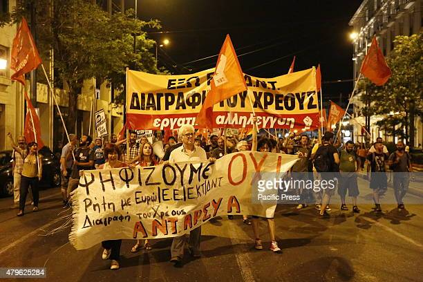 STREET ATHENS ATTICA GREECE Some Greeks march through Athens to Panepistimio Street to celebrate the win of the 'Oxi' side in the Greek referendum...