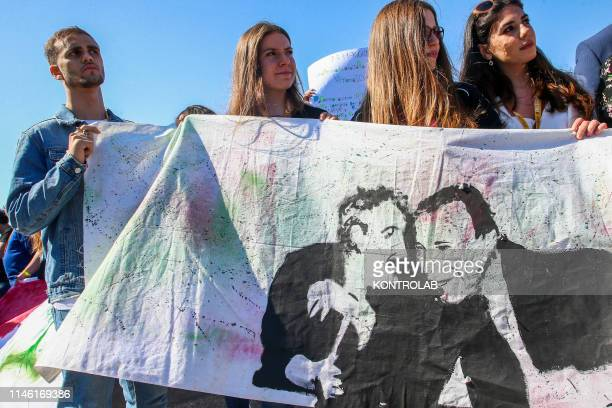 Some guys with banner of judges Giovanni Falcone, Paolo Borsellino during the demonstration to celebrate the memory of the massacres of Capaci and...