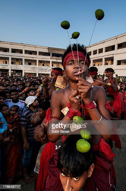 Some Hindu devotees with their tongue pierced with metal rods during the Shiva Gajan festival in the village of Krishnadebpur,at Burdwan dist. Of...