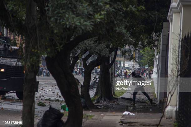 Some hooded in the demonstrations that lasted more than five hours in the vicinity of the Pedagogical University of Bogota Colombia on 13 September...