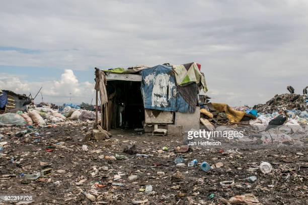 Some hundred pickers live at the Dandora rubbish dump on March 14 2018 in Nairobi Kenya The Dandora landfield is located 8 Kilometer east of the city...