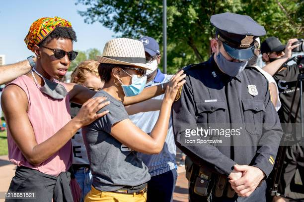 Some in the crowd pray for a policeman during the City Collective Prayer March on June 7 in Norfolk VA The event Prayer March A Peaceful...