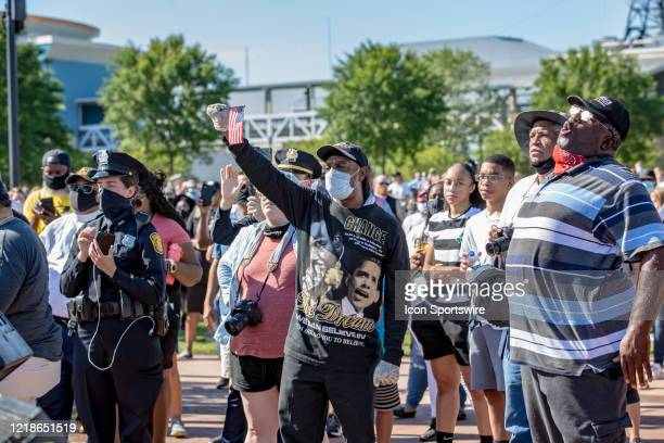 Some in the crowd shout or raise an American flag during the City Collective Prayer March on June 7 in Norfolk VA The event Prayer March A Peaceful...