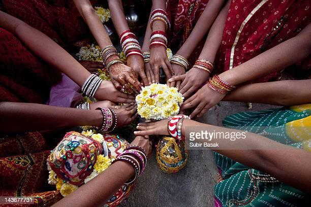Some Indian girls praying together