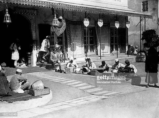 Some Indian metal engravers working near a shop Jaipur 1930s