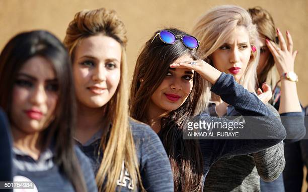 Some Iraqi candidates for Miss Iraq beauty contest pose at the ancient archaeological site of Babylon south of the capital Baghdad on December 17...