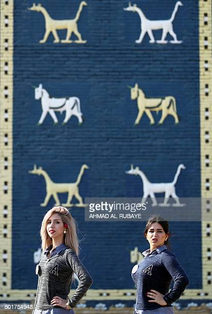 Some Iraqi candidates for Miss Iraq beauty contest pose in front of the Ishtar Gate at the ancient archaeological site of Babylon south of the...