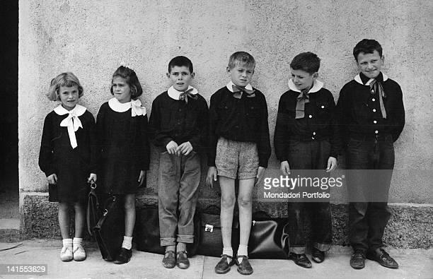 Some Italian schoolboys and schoolgirls posing in an elementary school Ovrano June 1961