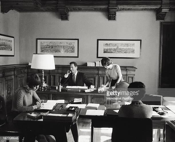 Some Italian secretaries working with their Italian office supervisor. Italy, 1965