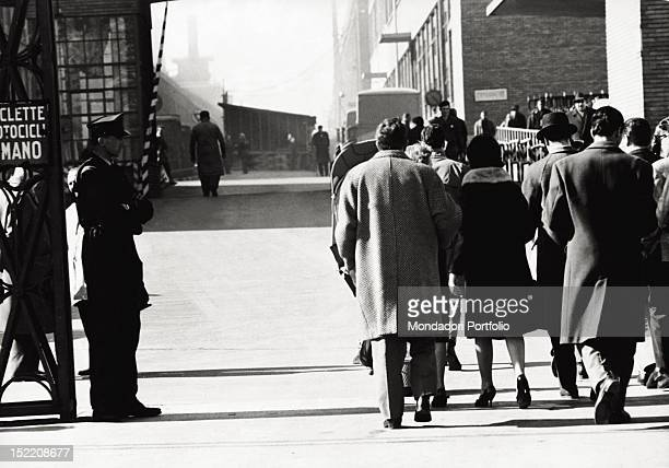 Some Italian workers and employees coming out of Fiat factory Turin March 1963