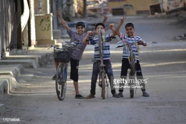 CONTENT] some kids are playing with their bicycles in the city of Dayr Az Zawr city in the east of Syria