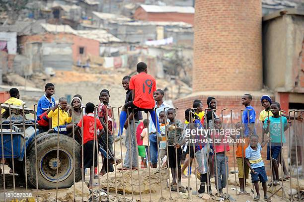 Some kids stand at the Boa Vista slum in the outskirts of Luanda on August 31 2012 The ruling Popular Movement for the Liberation of Angola party of...