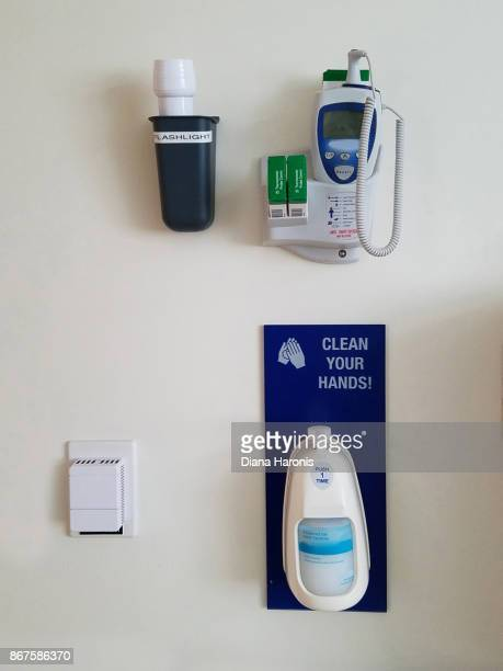 some medical equipment is hanging on the wall of a hospital room23rd - hand sanitizer stock pictures, royalty-free photos & images