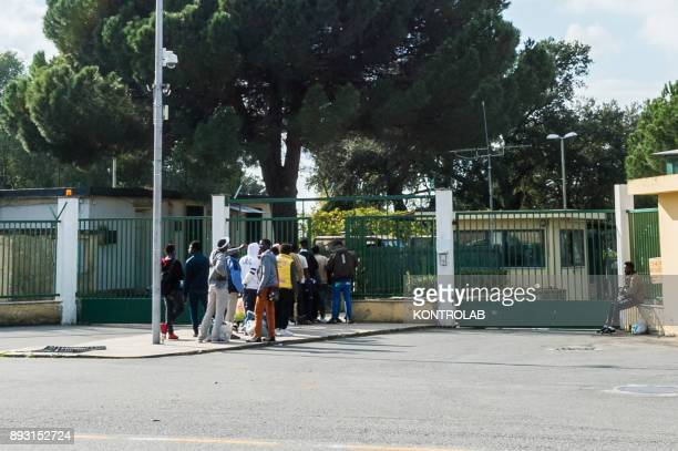 RIZZUTO CROTONE CALABRIA ITALY Some migrants are in line to enter the CIE of Crotone in Sant'Anna Isola Capo Rizzuto in Calabria southern Italy