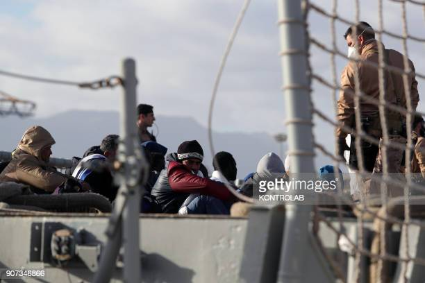Some migrants during landing of 210 migrants to Palermo from the Spanish ship Santa Maria Many of the migrants are women with small children and...