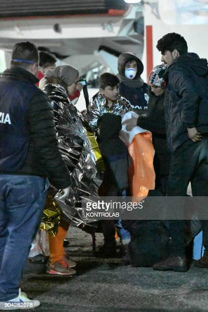 Some migrants during the landing by ship Diciotti of the Italian Coast Guard occurred in the port of Crotone in Calabria southern Italy The 277...