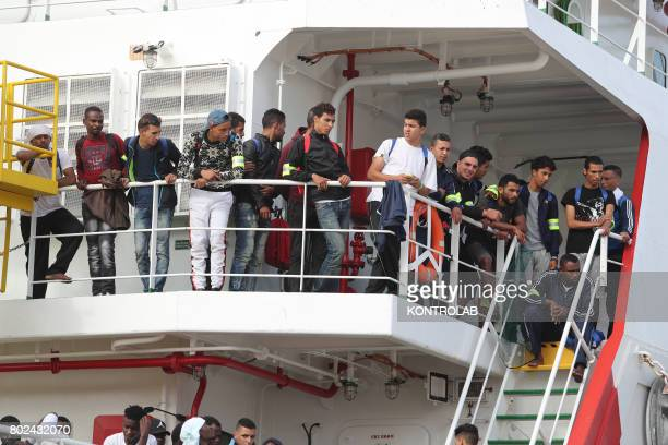 Some migrants during the landing by ship Vos Prudence in Palermo, Sicily, southern Italy. 877 migrants landed, including 94 women, 53 unaccompanied...
