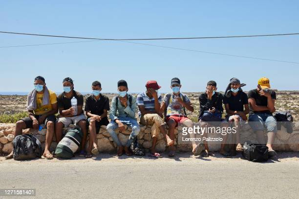 Some migrants from Tunisia who arrived at sunrise with an independent landing without being intercepted, await the arrival of health workers for...